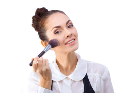 Beauty Girl with Makeup Brushes. Natural Make-up for Brunette Woman with Brown Eyes. Beautiful Face. Makeover. Perfect Skin. Applying Makeup Stock Photo