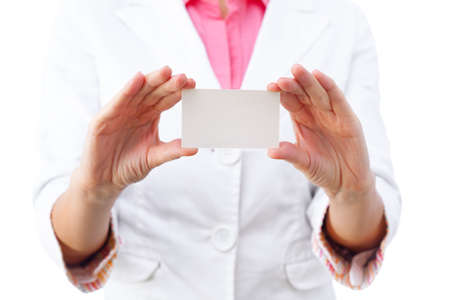 Business card closeup - businesswoman in white suit holding blank empty sign. photo