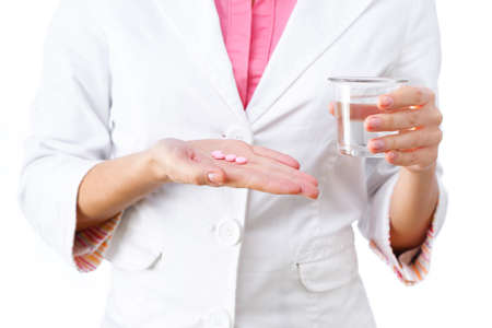 Women doctor holding medicine in hand and glass of water.  All isolated on white background. photo