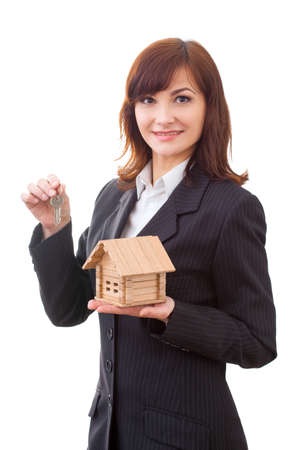 business, real estate and banking concept - smiling businesswoman with house keys and house photo