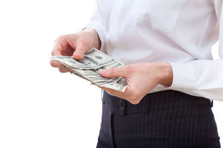 Business executive in formal suit counts money Stock Photo