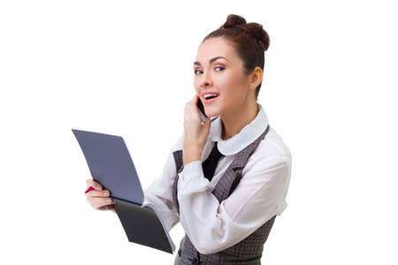 business concept - businesswoman talking on the phone and taking notes photo