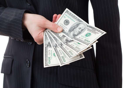 giving money: Business executive in formal suit giving money as a bribe