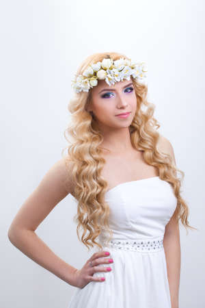 Beautiful girl with flowers in her hair studio shot photo