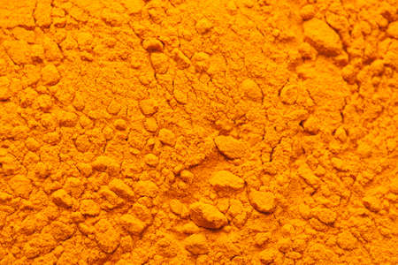 tumeric: Tumeric spice filling the frame. Orange color