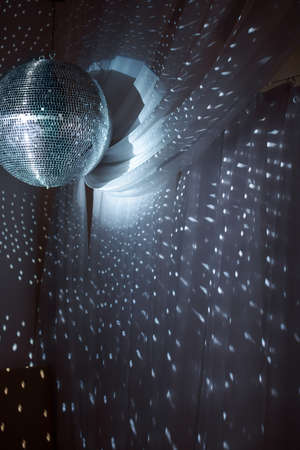 Shiny disco ball on nightclub good for background