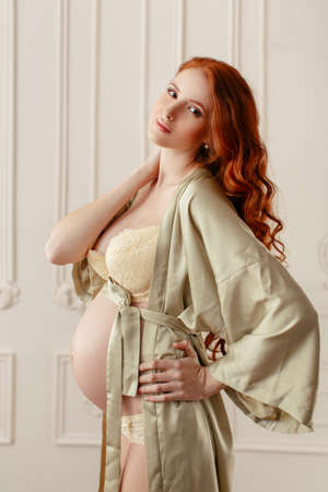pregnant lingerie: Slim beautiful pregnant model posing at home. Beautiful lingerie. Stylish and sexy pregnancy.