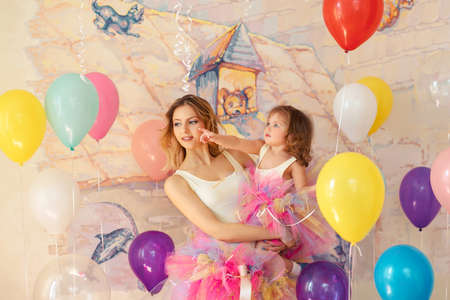 Happy woman and young girl celebrate birthday. Mother day concept
