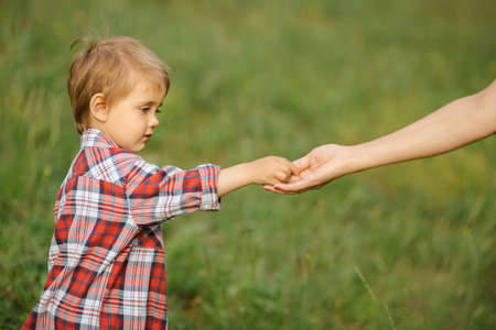 Child give his parent something on the nature