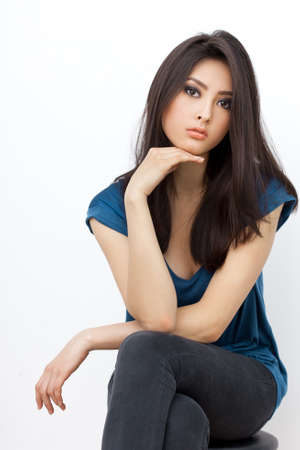 Portrait of beautiful young woman with serious look. Mixed race Asian Chinese White Caucasian female model. Stock Photo