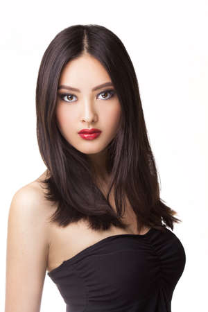 Beautiful young asian woman with long hair on white isolated background