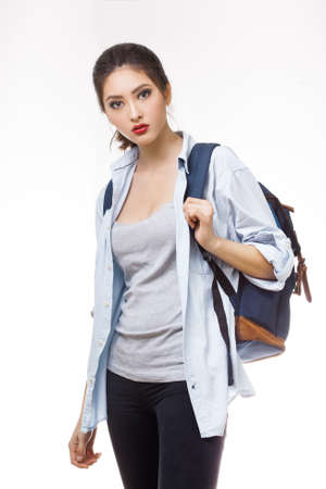 high spirited: Portrait of teenager girl with school backpack isolated on white background. Good for sport and travel concept Stock Photo