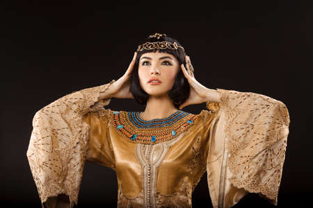 Woman having headache. Glamorous closeup portrait of beautiful sexy stylish brunette young woman model with bright makeup. Cleopatra