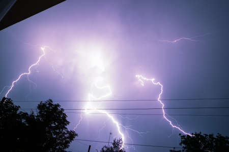 Real Lightning Bolt In City During A Storm Seen From House Window Stock Photo