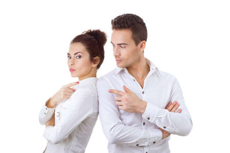 not talking: Unhappy couple not talking after an argument against white isolated background