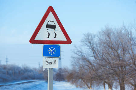 Winter Driving Caution Risk of Snow and Ice Stock Photo