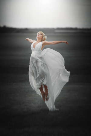 Beautiful Girl in blowing Dress Flying. Free. Freedom concept