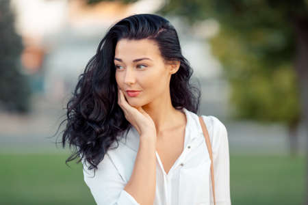 lovely businesswoman: Woman smiling - portrait of happy lovely and beautiful mixed race asian caucasian young businesswoman in casual clothes outdoor in the city park