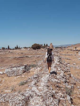 Ruins of ancient Hierapolis with tourist Pamukkale, Denizili, Turkey Stock Photo