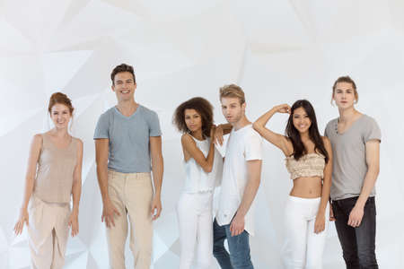 Group of young multi-ethnic beautiful people wearing casual clothes smiling and having fun together against white