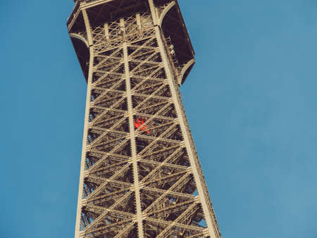 Paris, France .The main elevator in the inside of the Eiffel tower. One of the unusual Eiffel Tower lifts that take passengers to the viewing platforms. They are located on the legs of the tower and follow the curvature of the structure 版權商用圖片