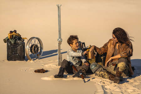 Post apocalyptic woman and boy sitting in the camp outdoors.
