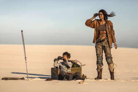 Post apocalyptic hero woman and boy with binoculars outdoors.