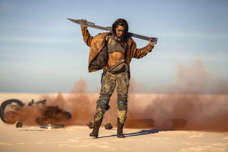 Post-apocalyptic biker woman with weapon outdoors.