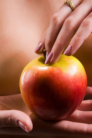 Nude young woman holding apple Stock Photo - 5413909