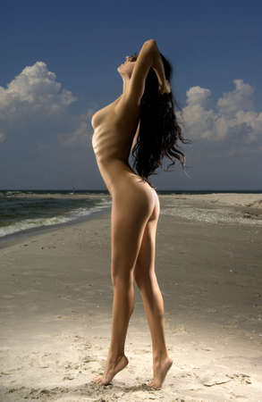 nude nature: naked young woman in the sea