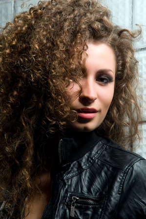 Portrait of young woman with curly hair Stock Photo - 7423417