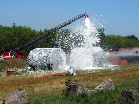 extinguishing burning gasoline special foam Stock Photo