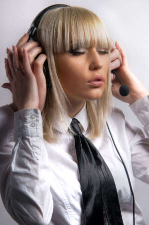 woman wearing headphones and a microphone - Customer Service photo