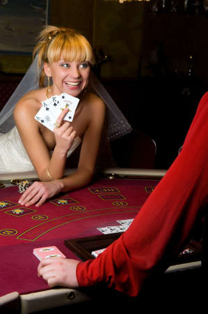 young woman in a wedding dress in casino photo
