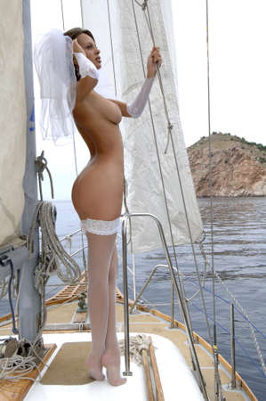young woman on a yacht Stock Photo