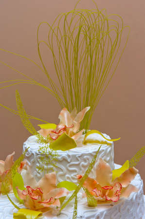 cake with flowers on textured background photo