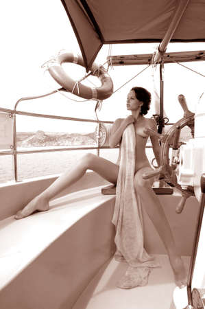 young naked woman on a yacht