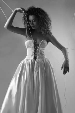 Bride tied with rope like a doll Stock Photo - 8006756