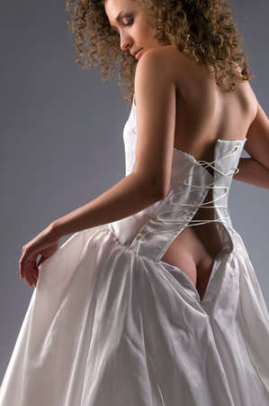 beautiful bride takes off her dress photo