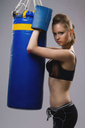 the woman in boxing gloves and pear photo