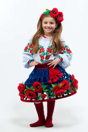 Young pretty girl in a ukrainian national costume on a light background photo