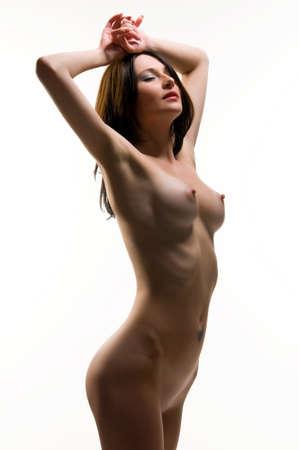 beautiful naked brunette on white background Stock Photo