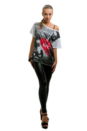 breeches: skinny babe in a long blouse and black leather breeches Stock Photo