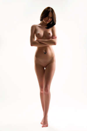 nude lady: woman body on an isolated background in studio