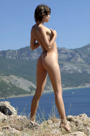 Young woman standing near the cliff Stock Photo - 8205975
