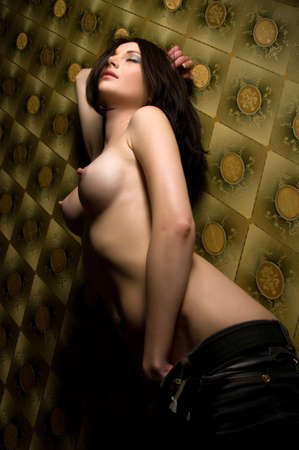 beautiful naked brunette close to the wall Stock Photo