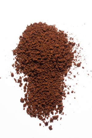 instant coffee scattered on the white surface Фото со стока