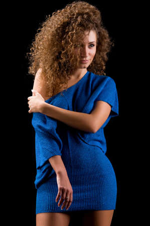 young woman with a slender figure in a blue blouse Stock Photo - 8885861
