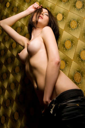 wet breast: Nude woman standing near a wall with colored wallpaper