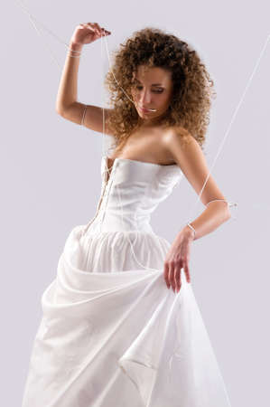young woman in a wedding dress photo